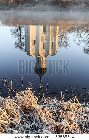 Reflection Of The Traditional Russian Church In The Gulf Of The Nerl River In The Early Autumn Morni