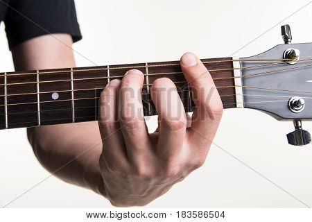 The Guitarist's Hand Clamps The Chord F On The Guitar, On A White Background. Horizontal Frame