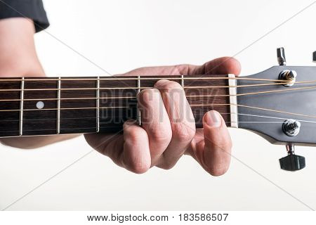 The Guitarist's Hand Clamps The Chord Em On The Guitar, On A White Background. Horizontal Frame
