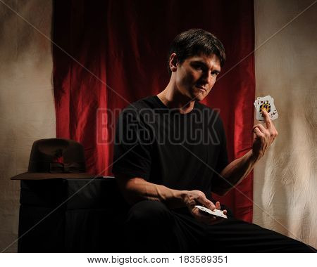 The sexy man is getting ready for play poker.