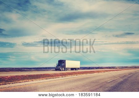Color Toned Picture Of American Highway Landscape With Semi Trailer Truck