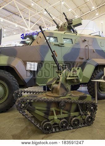 Kiev Ukraine - October 14 2016: Remote controlled platform on tracks with machine gun at the exhibition
