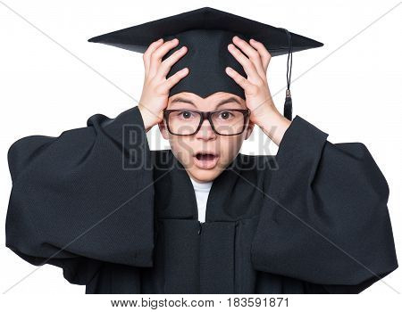 Portrait of a sad or surprised graduate teen boy student in mantle with black hat and eyeglasses, isolated on white background