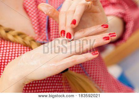Woman Applying Hand Cream On Hands