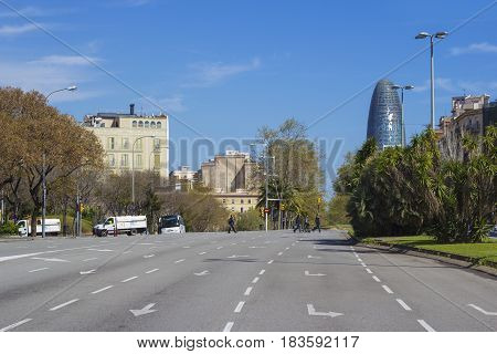 Barcelona Spain - 26 March 2017: View on the typical street of Barcelona and Torre Agbar busines center.