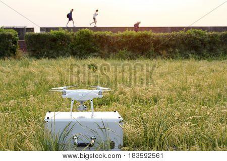 KAGAWA, JAPAN - APRIL 23, 2017: White drone Dji Phantom4Pro stay on metal bag and ready to fly.