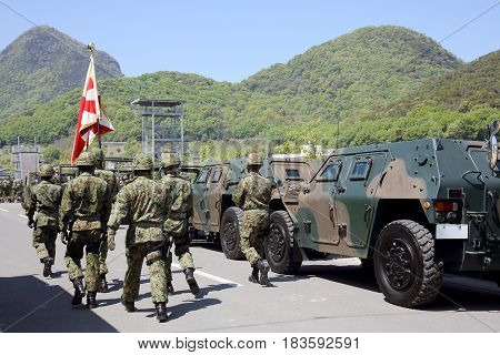 Kagawa, Japan - April 23 2017: Japanese soldier marching orders with the armored vehicle at the Zentuji military base