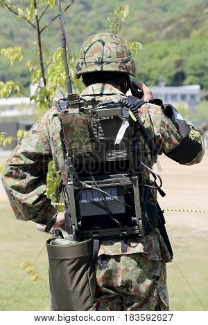 Kagawa, Japan - April 23 2017: Japanese soldier is shouldered transceiver at the Zentuji, Kagawa military base