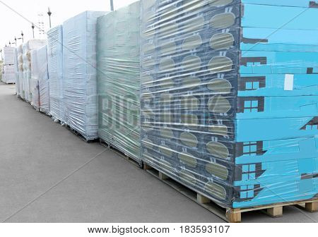 Packs with goods for wholesale distribution outdoors