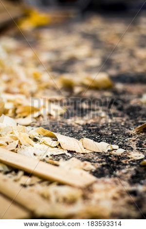 shavings of wood and sawdust on the floor of a carpenter's workshop