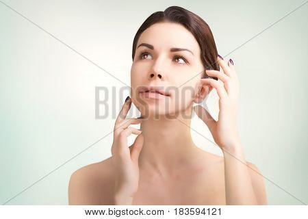 gorgeous european dark haired model portrait on grey