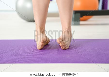Feet of woman doing exercises in clinic