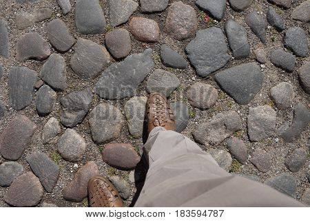 Stone pavement. Ancient pavement. Road paved with cobblestone