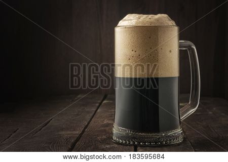 Dark Beer Mug With Foam On Dark Background