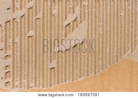 Close up of side view of a textured recycled packing cardboard with natural fiber parts