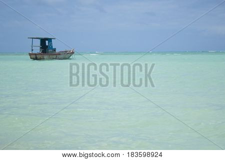 Boat in the sea of crystal clear and calm waters.