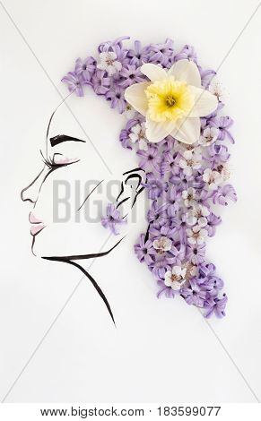 Hand drawn beautiful female profile with natural narcissus flower hairstyle isolated over white. Fashion illustration