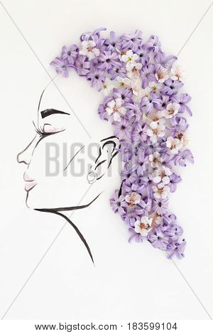 Hand drawn beautiful female profile with natural flowers hairstyle isolated over white. Fashion illustration