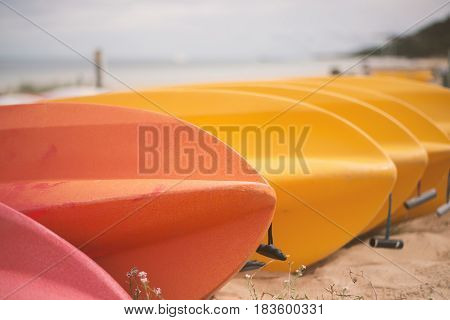 Kayaks On The Beach During The Day