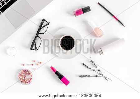 set of decorative cosmetics for women with lavender flowers on white office table background top view