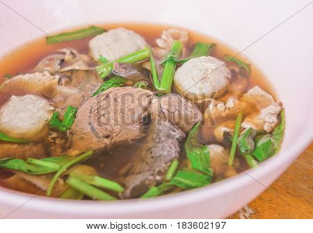 Braised beef clear with meat tendon and meat balls soup stew (Ekaehla meat) with vegetable in bowl