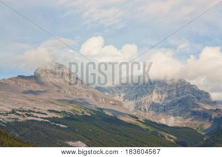 Landscape of Canadian Rocky Mountains in the clouds.