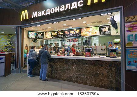 SAINT PETERSBURG, RUSSIA - CIRCA APRIL, 2017: McDonald's restaurant at Mega Dybenko. McDonald's is an American hamburger and fast food restaurant chain.