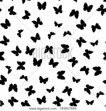 Random black and white butterflies silhouettes pattern.