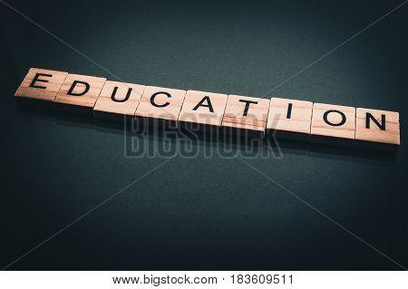 Wood Block Education Word Over Backboard School. Education Word Formed By Educational Wood Block. Ed