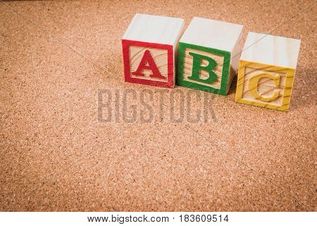 Wood letter blocks alphabet ABC for practice english alphabet for kids on school desk. ABC practice concept.