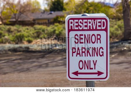Red & White Sign Showing Parking For Senior Citizens Only