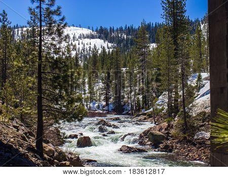Mountain Stream Rushing Due To Snow Melt