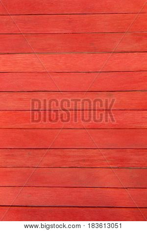 This is a photograph of Red colored popsicle sticks background