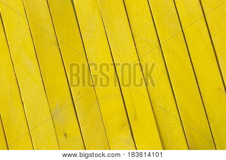 This is a photograph of Yellow colored popsicle sticks background