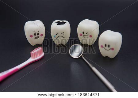 Model Cute toys teeth in dentistry on a black background.