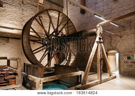 Mechelen Belgium - July 30 2016: Bells mechanism of Cathedral of Mechelen. Some of the original carillon's set of 49 bells are still in working order. The flat-topped silhouette of the cathedral's tower is easily recognizable.