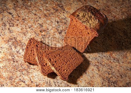 Black sliced bread on the table. close-up
