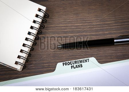 Procurement Plans Concept.  Folder Register on a dark wooden desk.