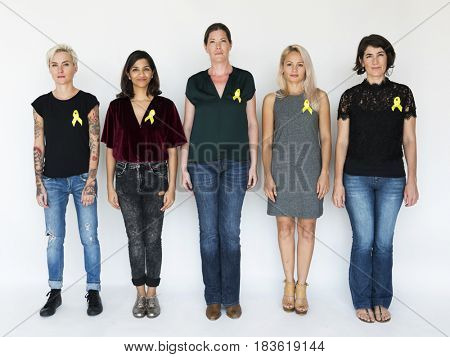 Group of Diverse People with Yellow Ribbon Represent  Sarcoma Cancer
