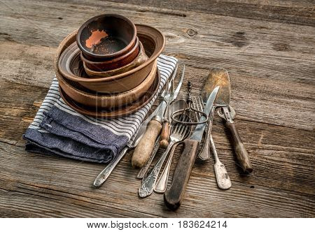 Set of rustic fine brown utensils, napkin and plates ready to be served