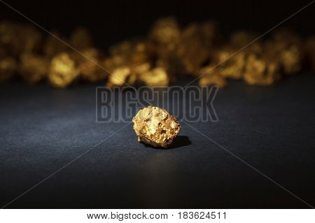 Closeup of big gold nugget on a black background