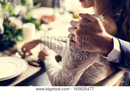 Groom Holding Bride Closely on Wedding Reception