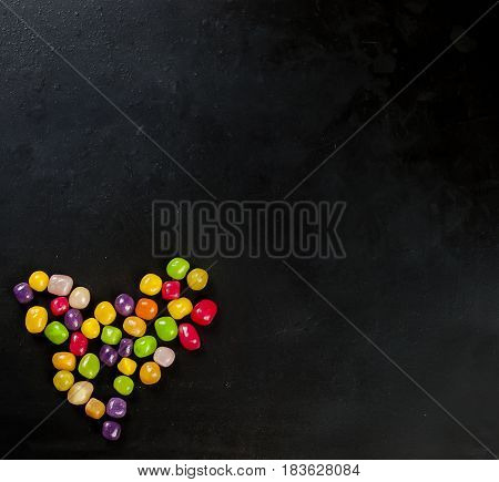 Candy Heart On Black Background Top View