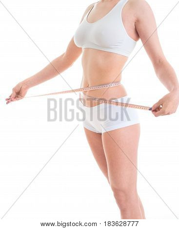 young woman caring for the figure measuring her body with tape isolated on white background