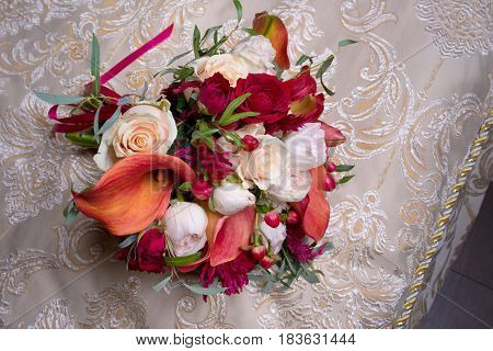 Wedding bouquet with white and red roses and red Calla lilies