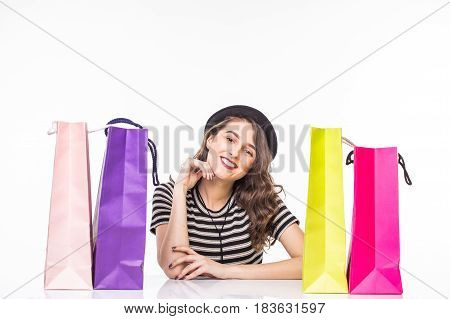 Young Beautiful Young Woman With Shopping Bags On Table Satisfied And Have Rest With Happy Smile On