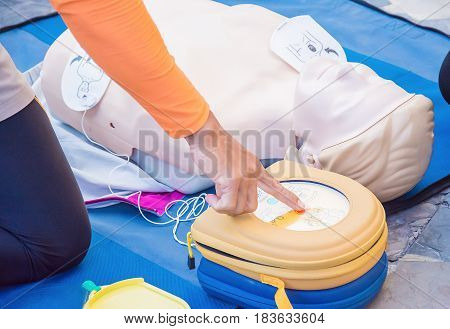 cpr training chest compression dummy basic life support selective focus of finger