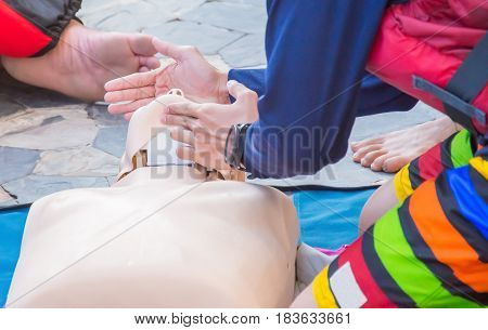 cpr training chest compression dummy basic life support selective focus of hand and chin
