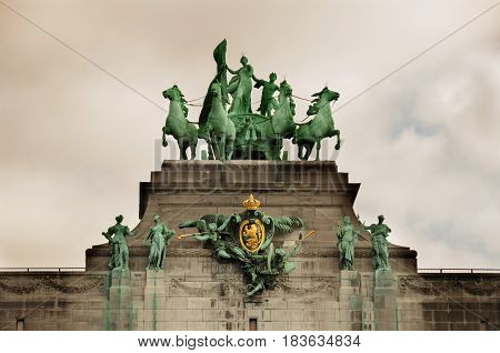 Triumphal arch (Arc de Triomphe) in Cinquantenaire park in Brussels was planned for National Exhibition of 1880 to commemorate 50th anniversary of the independence of Belgium.