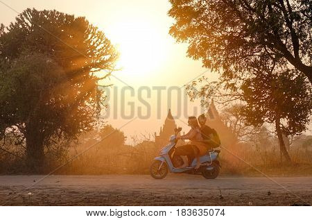 Tourists Riding Electric Bike On Dusty Road